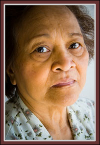 Distraught Senior Woman:  Protect seniors physically, emotionally, financially.